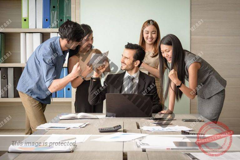 Business people happy after signing agreement in office, successful teamwork concept